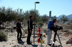 "Patricia Benabe, José ""Inerzia"" Longás and Claudio Rocha follow journalist Sergio Haro on assignment at a municipal graveyard in Mexicali, Mexico."