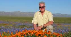 Huell Howser amongst the California poppies, wearing his iconic sunglasses an...