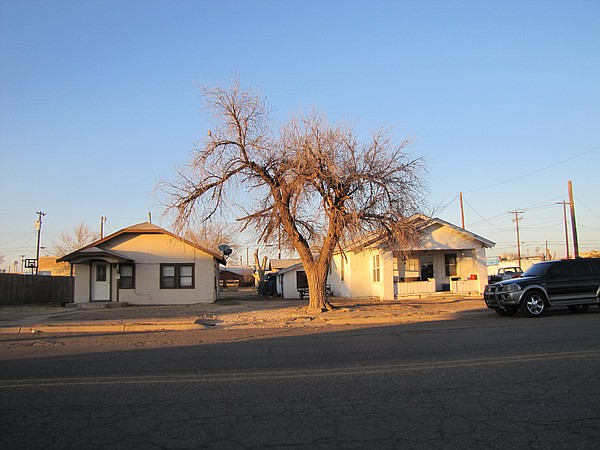 Police say these two rental homes in central Portales, N.M. were used in a sc...