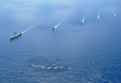 Ships and aircraft assigned to the Nimitz Carrier Strike Group (CSG) 11 operate in formation in the South China Sea in 2010.