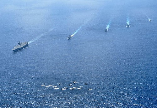 Ships and aircraft assigned to the Nimitz Carrier Strike Group (CSG) 11 opera...