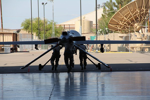 Predator being pushed out of hangar at Holloman Air Force base.