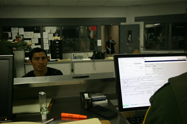 A man from Veracruz awaits processing at the U.S. Border Patrol detention center in Nogales, Ariz.
