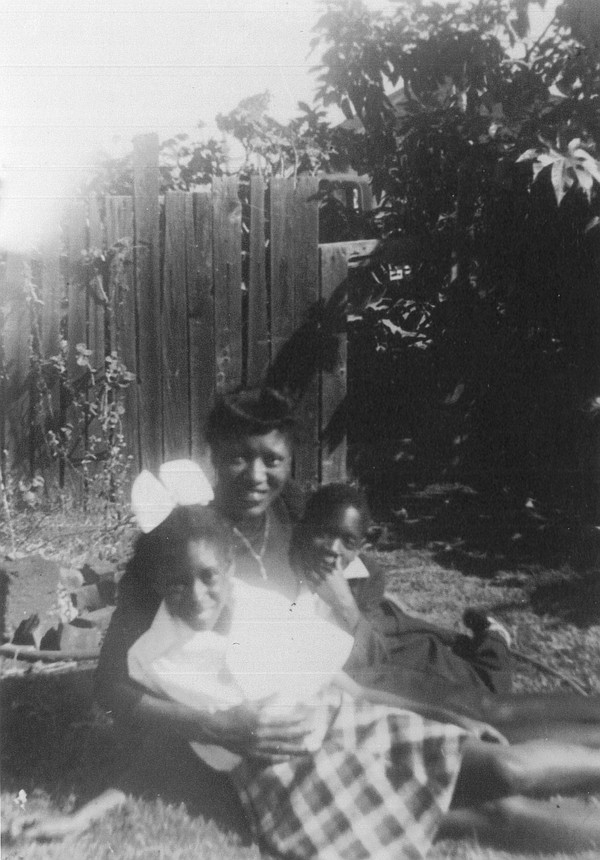 Jackson in his backyard with his mother, Johnnie Beatrice Jackson and his sis...