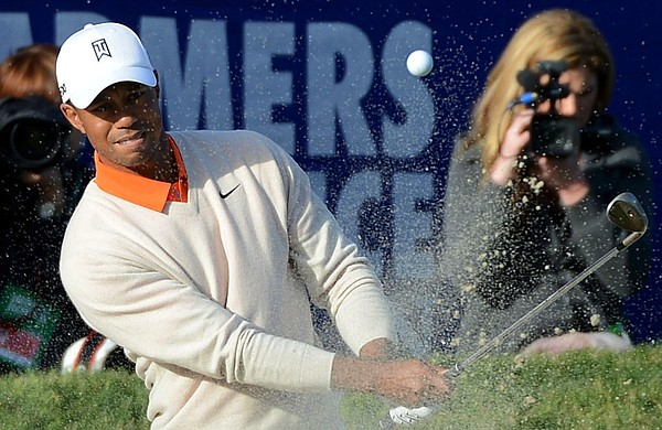 LA JOLLA, CA - JANUARY 24: Tiger Woods hits out of the bunker on the 18th hol...