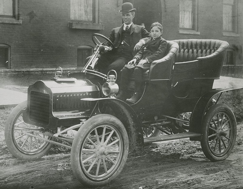Henry Ford and Edsel Ford in Ford Model F Automobile, 1905.
