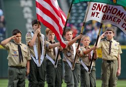 Members of the Boy Scouts of America participate in pre-game ceremonies prior...