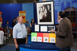 Appraiser Simeon Lipman (right) with a guest and his Beatles records and lett...