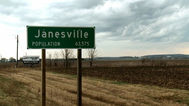Sign for Janesville, Wisconsin, population 63,575. About 1/6 of Janesville's population lost their jobs when GM and other companies shut their doors in the wake of a recession.