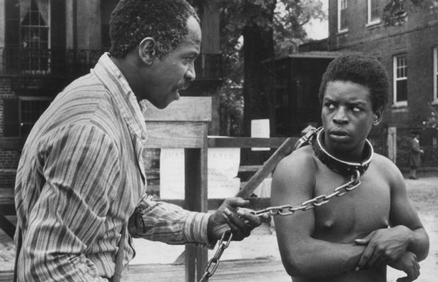 "Fiddler (Louis Gossett Jr.) offers sage advice to Kunta Kinte (LeVar Burton) in the 1977 miniseries ""Roots."""