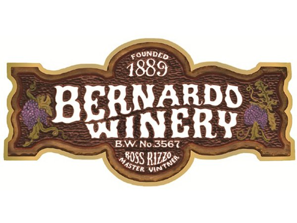 This auction item is a wine basket from Bernardo Winery.  Items include:  a bottle of Chalis, a bottle of Cabernet Sauvignon, a wine coaster, a jar of Queen Olives stuffed with blue cheese, two tasting cards, beverage napkins, and a box of John WM. Macy's CheeseCrisps.