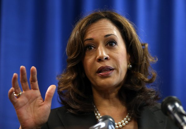 California Attorney General Kamala Harris speaks to repor...