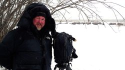 Filmmaker Jeff Turner filming buffalo in winter.