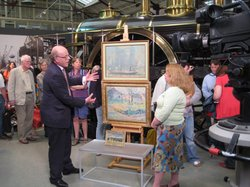 Paintings specialist Dendy Easton examines two pictures.