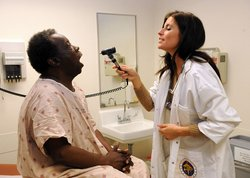 Nurse practitioner Tiffany Holm performs a routine physical on Willie Benjamin at the Tricare Outpatient Clinic-Clairemont Mesa operated by Naval Medical Center San Diego.