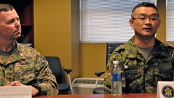 Marine Col. C.D. Taylor, commander of Camp Pendleton's 13th Marine Expeditionary Unit, and Japanese Col. Matsushi Kunii, commander of the Western Army Infantry Regiment, Japan Ground Self Defense Force, during a press conference at Camp Pendleton Feb. 11, 2013. The two are leading units working together in the Iron Fist exercise held in Southern California.