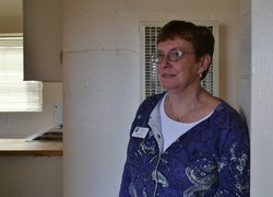 Julie Weber, head of the housing department at NMSU, gives a tour of a family...