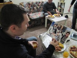 Blake Hall looks at a montage of photos of Roy, his fallen Iraqi translator. ...