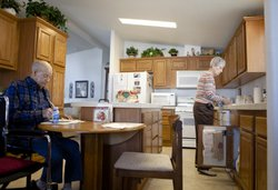 Betty makes lunch for her husband LC at their home.