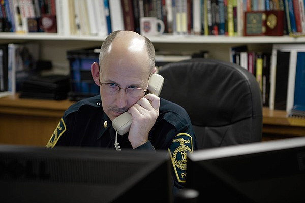 Gene Deisinger, Director of Threat Management, on the phone in his office at ...