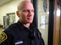 SRO Tom Tomlinson, Roy police officer, being interviewed at Roy High School.