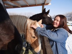 Megan Werhman, former Roy High School student, petting horses at her home in Utah.