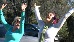 Laughter yoga participants in Balboa Park.