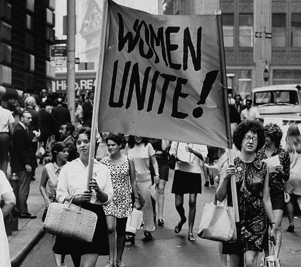 "Signs saying ""Women Unite"" carried by women supporters during a Women's Liber..."