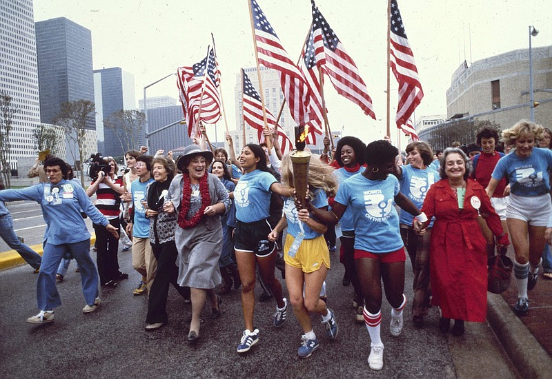 Leaders of the Women's Movement pass a torch that was carried by foot from Ne...