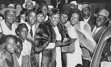 Sister Rosetta Tharpe (in fur coat) and Marie Knight (on the right with a fur stole) with fans after a concert in St. Louis on 3 June 1947.