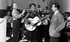 Sister Rosetta Tharpe recording at Decca Records with bandleader Lucky Millinder (left) and manager Moe Gale (right) in 1941.