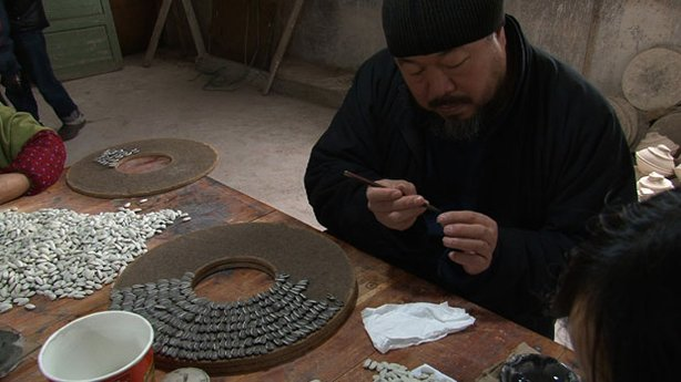 Ai Weiwei paints handcrafted porcelain sunflower seeds in Jingdezhen, China.
