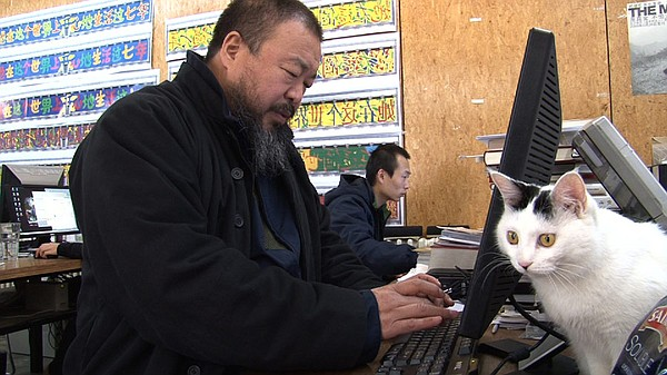Ai Weiwei works on his computer in his Beijing home studi...