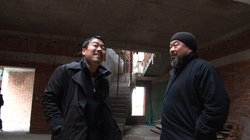 Ai Weiwei (right) and art assistant Inserk Yang (left) inspect the construction of a new studio in Shanghai in 2010.