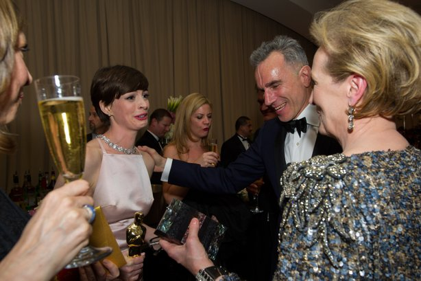 Backstage winners Anne Hathaway and Daniel Day-Lewis chat with Meryl Streep.