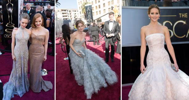 Amanda Sefried, Jessica Chastain, Amy Adams, and Jennifer Lawrence were all actress who received Oscar nominations or were in nominated films and choose to wear a bland, neutral colored gown.