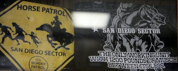 T-shirts are displayed under glass inside the Imperial Beach Horse Patrol's office. (Photo by Erin Siegal)