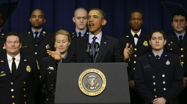 Surrounded by first responders who may be impacted by looming budget cuts, U.S. U.S. President Barack Obama speaks during an event at the Eisenhower Executive Office Building February 19, 2013 in Washington, DC.