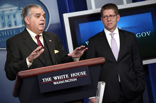 U.S. Secretary of Transportation Ray LaHood (L) answers questions during a br...