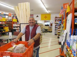 A staff member at RTD Hardware in Las Cruces stocks the aisles with merchandise.