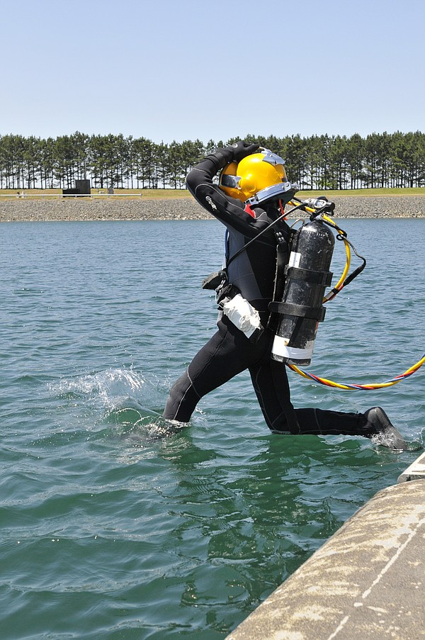 A diver jumps into the pond at Aberdeen Proving Ground in 2011.