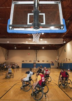 Marines competing in wheelchair basketball.
