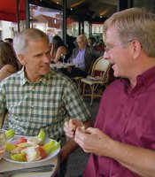 Co-author Steve Smith joins Rick Steves for a meal.