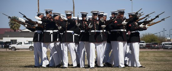 "The Marine Corps Silent Drill Platoon executes its ""bursting bomb"" formation during a Battle Color Detachment ceremony at Marine Corps Air Station Yuma, Ariz., March 1, 2012."