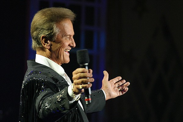 Pat Boone hosts and sings his hit song,