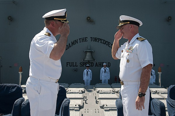 Capt. Timothy Kott, right, relieves Capt. Thomas Halvorso...