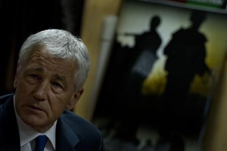 U.S. Secretary of Defense Chuck Hagel briefs the press in Kabul, Afghanistan,...