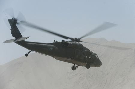 A UH-60 Black Hawk conducts a mission over northern Afgha...
