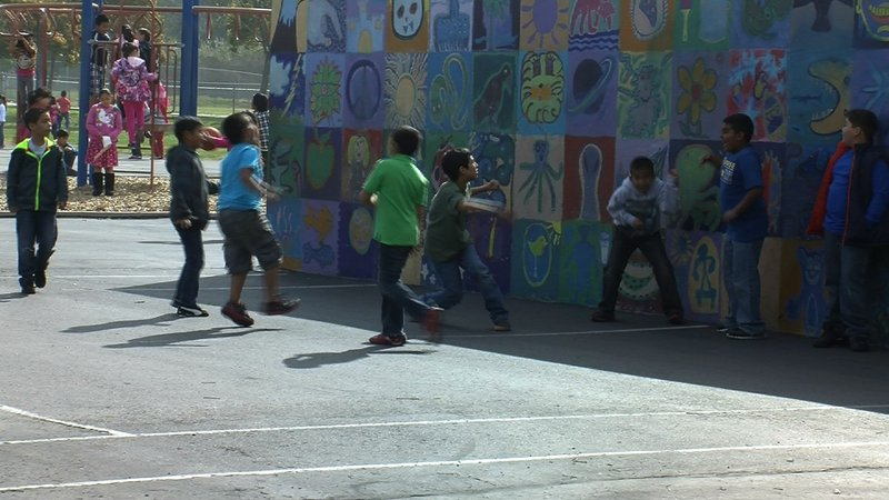 Children play outside during recess at Rice Elementary School in Chula Vista,...