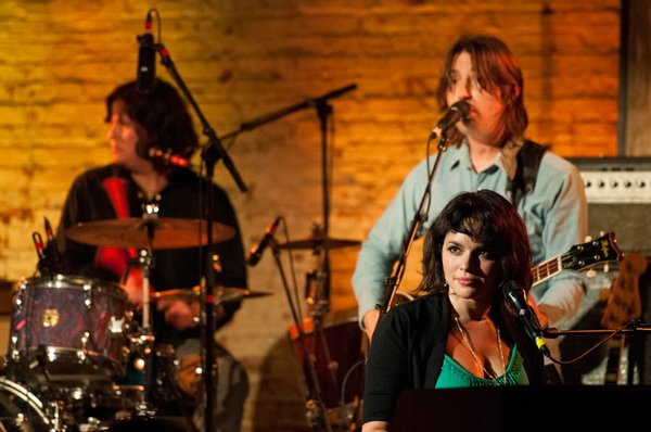 Left to Right: Greg Wieczorek, Josh Lattanzi and Norah Jones perform at the h...